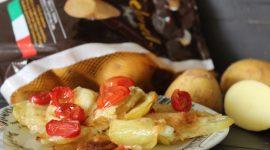 Chips di patate Selenella al forno con fontina e pomdorini